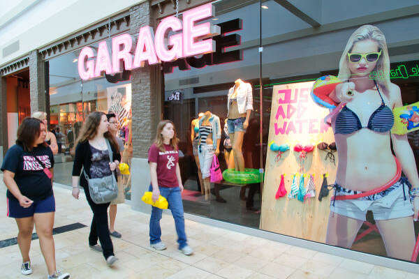 "Patrons peruse the Garage store at Baybrook Mall. Garage is the first such teen concept in Texas from the Canadian retailer. The hardest part of the sales job ""is delivering consistently compelling products,"" president Anna Martini says."