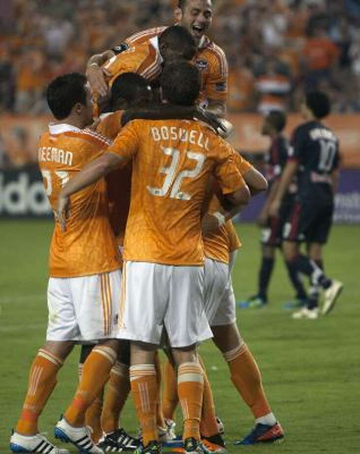 The Dynamo celebrate after Koke scored a goal in the second half on Saturday night. Photo: Cody Duty, Chronicle