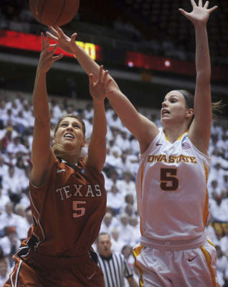 Texas guard Kathleen Nash, left, and Iowa State forward Halliea Christofferson reach for a rebound during the first half on Monday night. Photo: Amy Vinchattle, AP