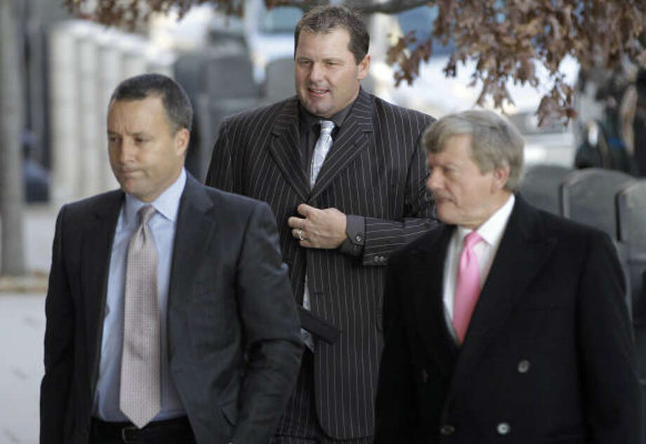 Lawyer Michael Attanasio, left, was brought into Roger Clemens' defense team in August in part to prepare for Andy Pettitte's testimony. Rusty Hardin is at right. Photo: Charles Dharapak, AP