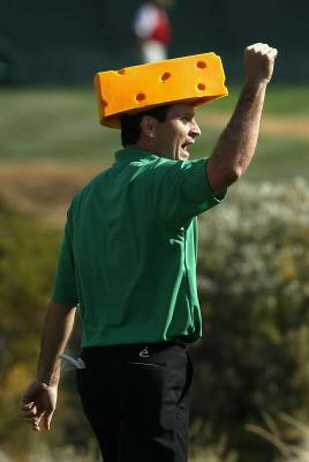 Mark Wilson cheers as he walks down the 16th hole in a Green Bay Packers cheese head during the third round on Sunday. Photo: Christian Petersen, Getty Images