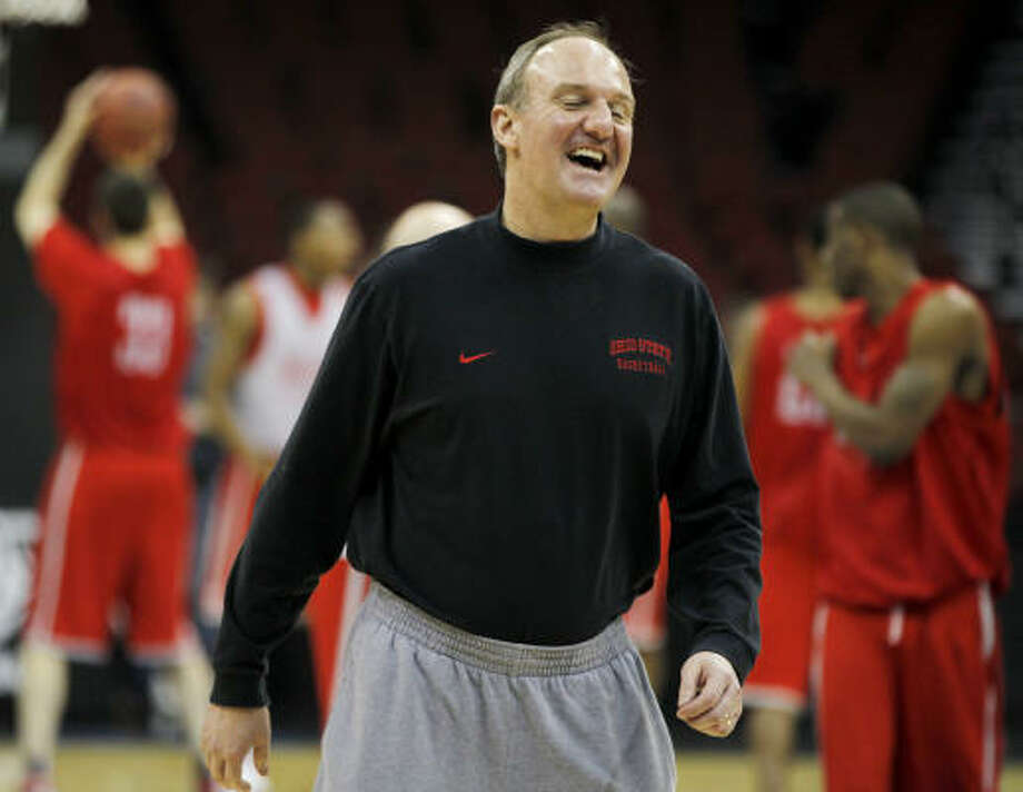 Ohio State coach Thad Matta may be all laughs at practice, but he vows to have his team be all business against Kentucky today. Photo: Julio Cortez, AP