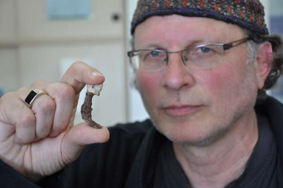 Journalist Simcha Jacobovici holds one of two nails reportedly found in a tomb thought to be the burial site of Caiaphas, the Jewish high priest who handed Jesus over to the Romans. Photo: Associated Producers Ltd.