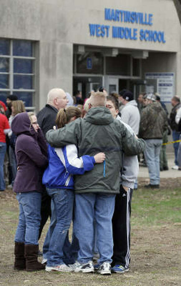 Parents and students gather after students were released following an early morning shooting at West Middle School in Martinsville, Ind., Friday. Photo: Darron Cummings, AP