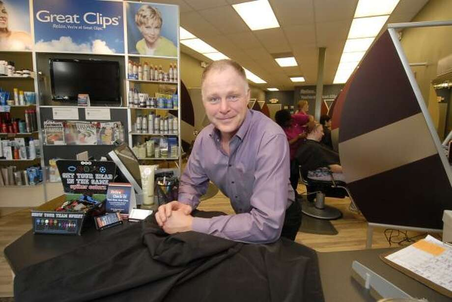 HAPPY TRANSITION: After more than a 20-year career as a consultant in office systems communications, Kelly Williams has found success and happiness at Great Clips. Photo: Tony Bullard:, For The Chronicle