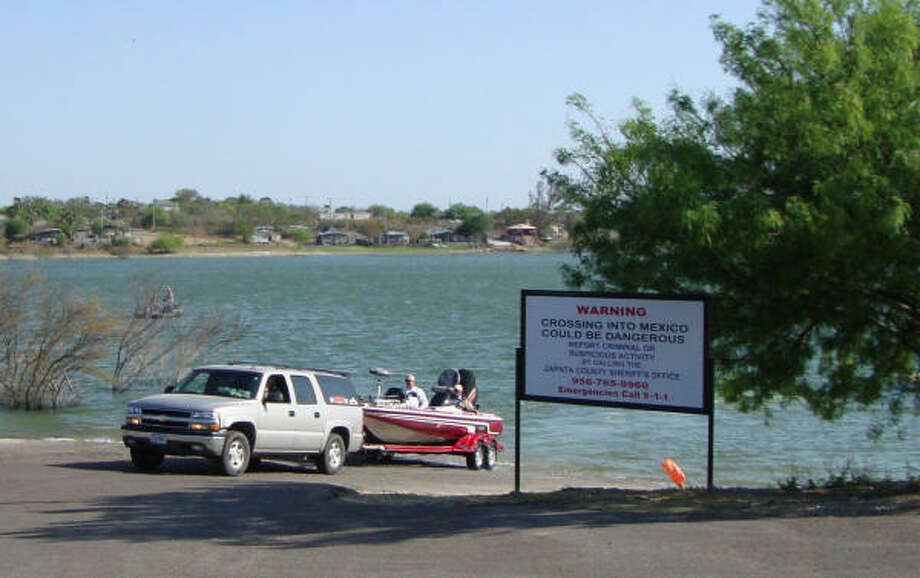 A bass boat is pulled from the water in Zapata after a day of fishing the Mexican side of Falcon Lake. Photo: Dudley Althaus, Houston Chroncle