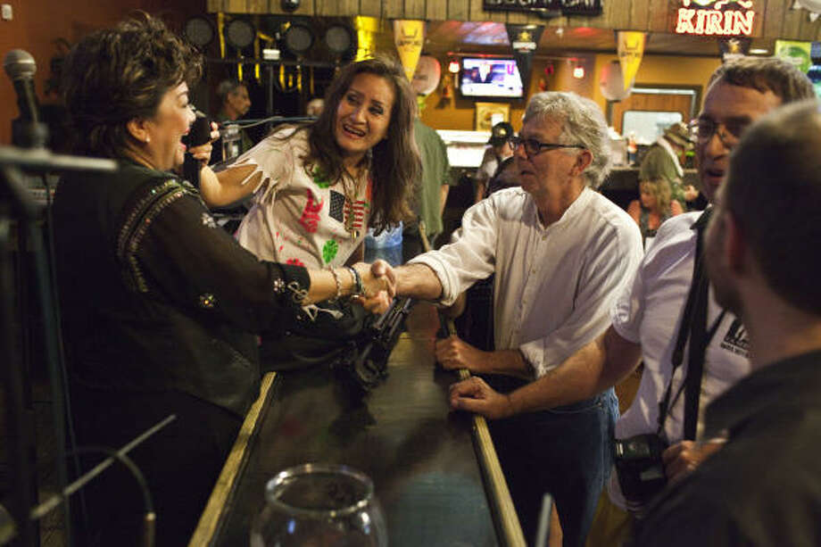 CBC band members Marie Louise Phan, left, and Loan Phan greet Allen Quinn as Vietnam vets and Vietnamese musicians gathered 40 years after an explosion changed their lives forever. Photo: Eric Kayne, Chronicle