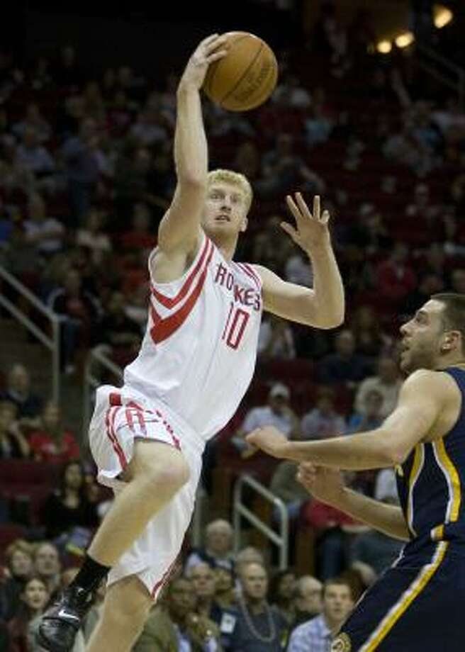 Rockets forward Chase Budinger looks to score two of his 18 points in Saturday night's win at Toyota Center. Photo: George Bridges, MCT