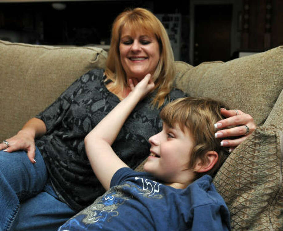 Rachel Fennell owes $7,000 in medical bills for her 12-year-old son, Reece, because her insurance covers only $10,000 for some - but not all - of his emotional and mental disorders. Photo: Robin Jerstad, San Antonio Express-News