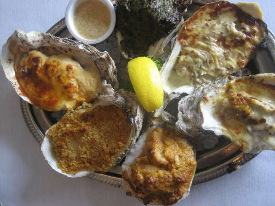 The Deluxe Oyster platter, an assortment of baked oysters with six different toppings, is one of the most popular dishes at Gaido's in Galveston. Photo: GREG MORAGO :, CHRONICLE