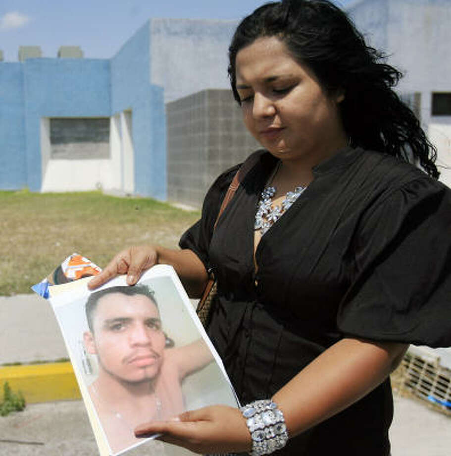 Rebecca Cruz Camacho's search for her brother Moises Cruz-Camacho has taken her to the Tamaulipas state morgue in Matamoros, where her mother gave a DNA sample on Saturday in hopes of identifying one of the 72 bodies there. Photo: Gabe Hernandez, San Antonio Express-News