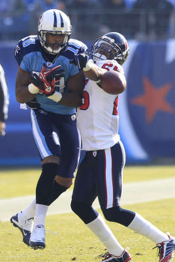 Texans cornerback Kareem Jackson allowed the second-most yards in league in his first season, but he successfully defended this pass intended for Titans wide receiver Kenny Britt. Photo: Brett Coomer, Chronicle