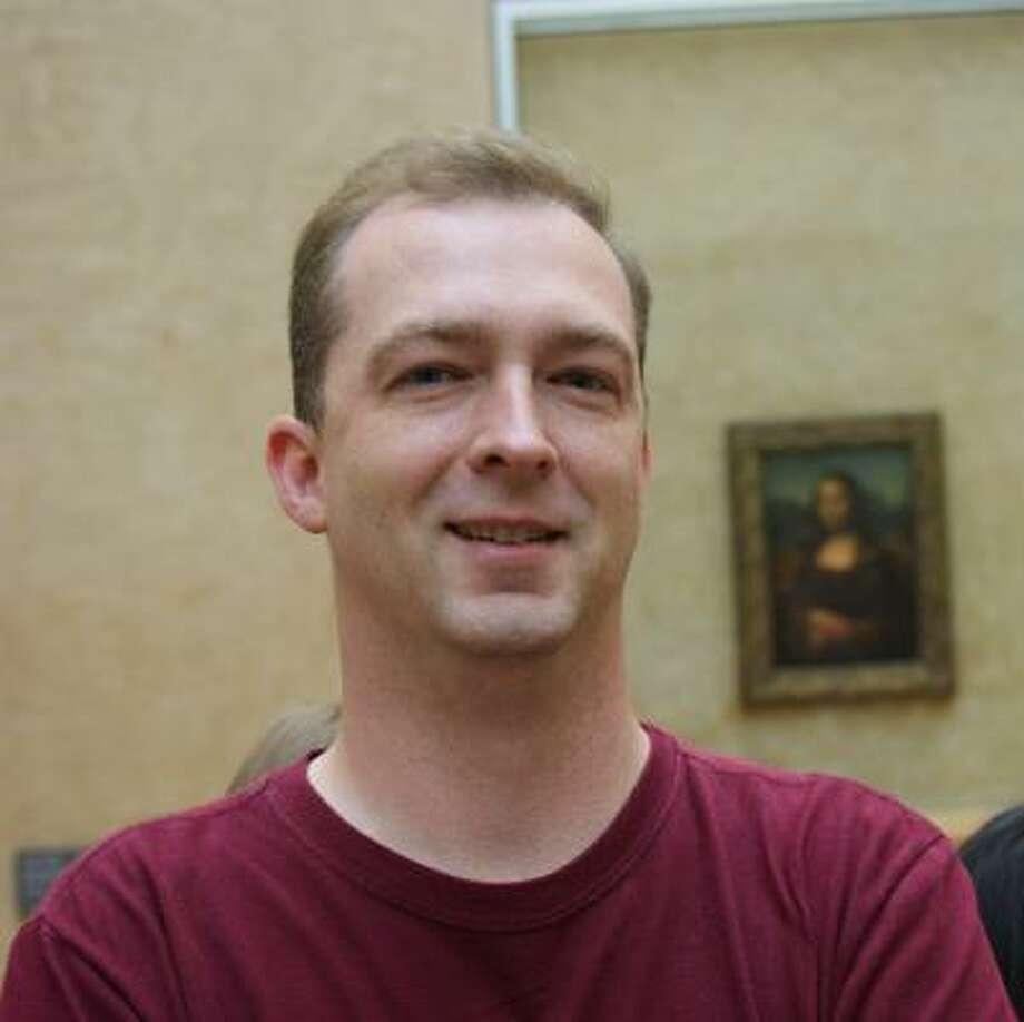 AMERICAN IN PARIS: Film critic Scott Chitwood of Cypress visited the Louvre Museum in Paris last summer. Photo: Dava Chitwood