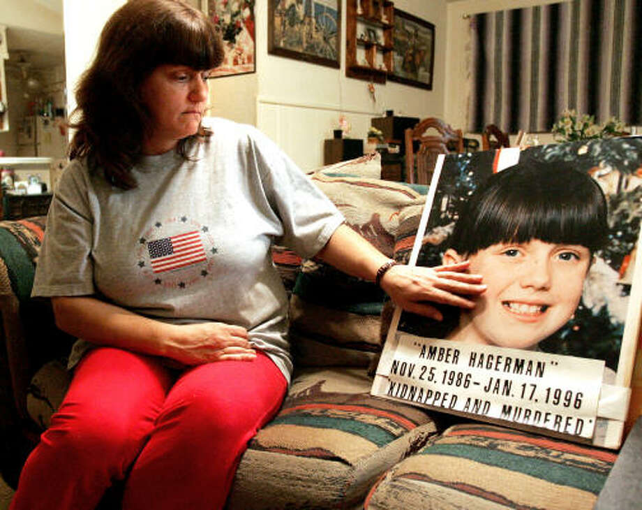 Donna Norris, of Hurst, caresses a photograph of her daughter, Amber Hagerman. Thursday marked the 15th anniversary of Amber's disappearance. Photo: R. Jeena Jacob, Fort Worth Star-Telegram