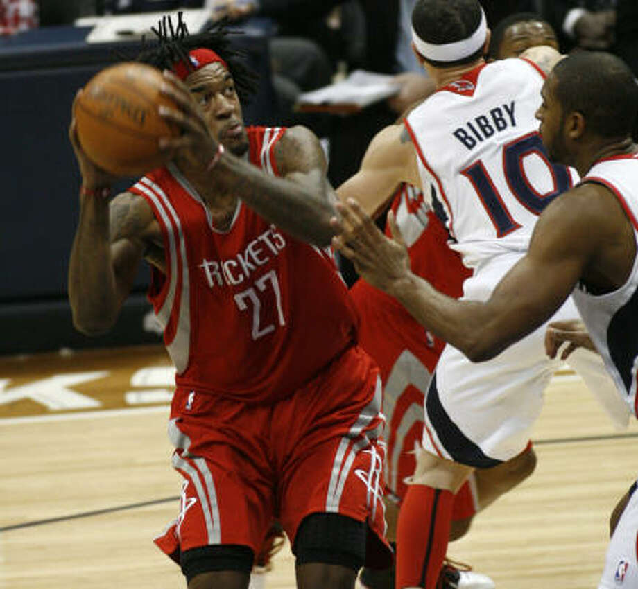 Jordan Hill and the Rockets put forth an inspired effort against the Hawks on Saturday night even though they had to travel for the second game of a back-to-back. Photo: John Amis, AP