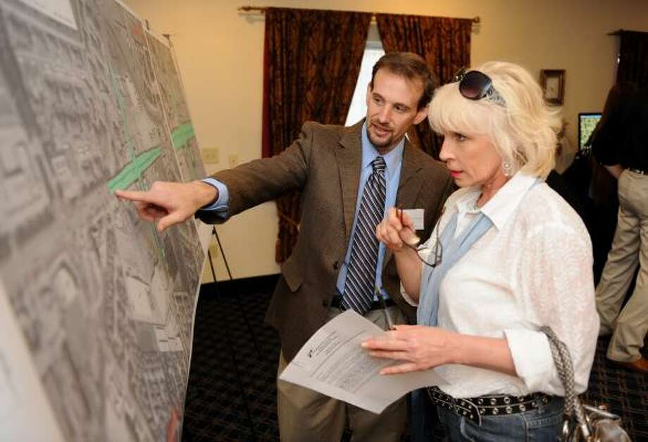 Patrick Gant with TxDOT goes over the map with Jill Costanzo of Copperfield Coalition during a public meeting about the proposed improvements to FM 1960 at Eldridge Parkway held at Holiday Inn Express on March 24. Photo: Thomas Nguyen, For The Chronicle