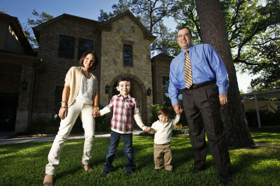 "The Casares family - Marlene and Jalin and their sons, Christian, 5, and Lucas, 1 - settled in Oak Forest a year ago. Stay-at-home mom Marlene is happy ""there's a cute little library my kids can walk to."" Photo: Michael Paulsen :, Chronicle"