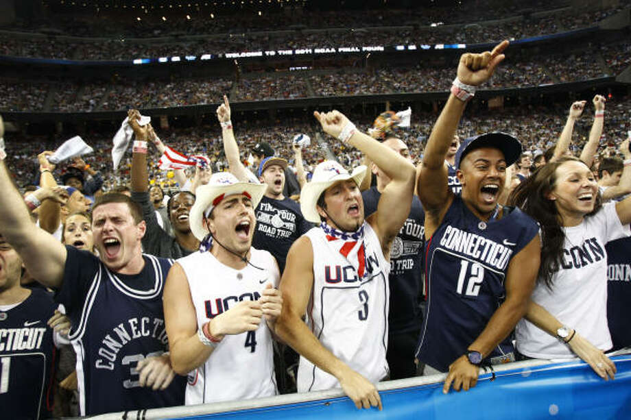 Connecticut fans celebrate during Monday's NCAA championship game victory at Reliant Stadium. Photo: Michael Paulsen, Chronicle