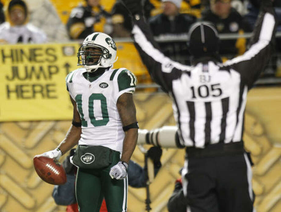 Santonio Holmes scored the Jets' first touchdown Sunday, but will it be his last for New York? Photo: Keith Srakocic, AP