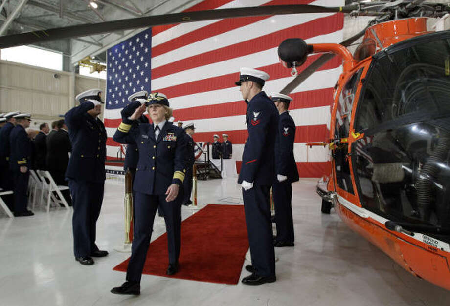 Coast Guard Rear Adm. Mary Landry salutes as she leaves a Friday ceremony honoring members of offshore supply vessel Damon B. Bankston and Coast Guard helicopter crews who helped rescue 115 survivors of last year's Deepwater Horizon explosion at Coast Guard Air Station New Orleans in Belle Chasse, La. Photo: Patrick Semansky:, AP