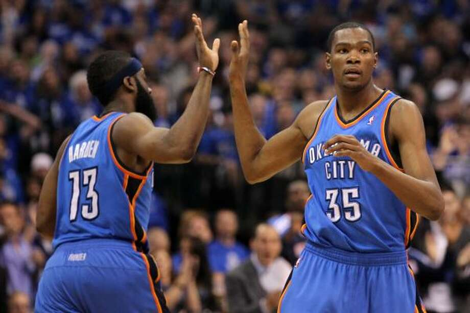 Thunder forward Kevin Durant high fives guard James Harden during the Game 2 win in Dallas. Photo: Ronald Martinez, Getty