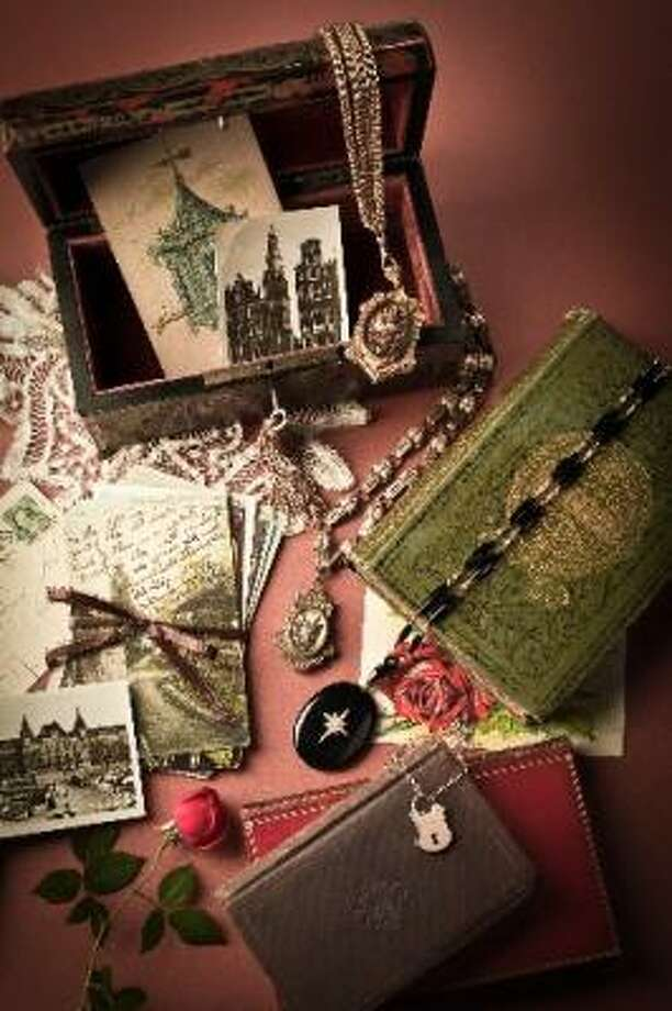 Lockets in still life settings that evoke a romantic past. Photo: Smiley N. Pool, Chronicle