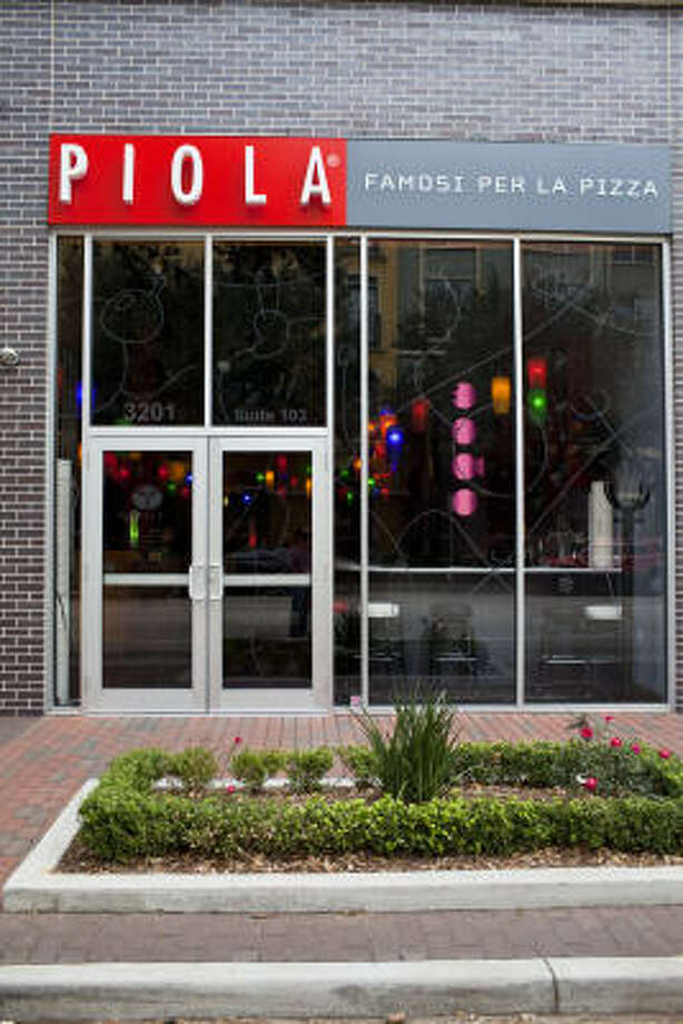 The exterior at Piola. Photo: Eric Kayne :, For The Chronicle