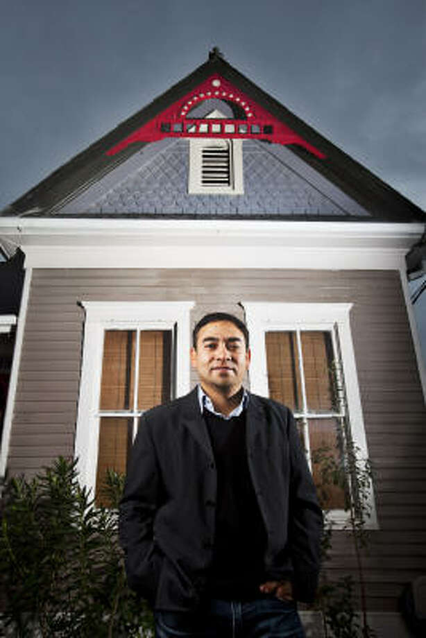 Saul Obregon and his restored Queen Anne cottage is the first Near Northside house to become a City of Houston Protected Landmark. Photo: Eric Kayne