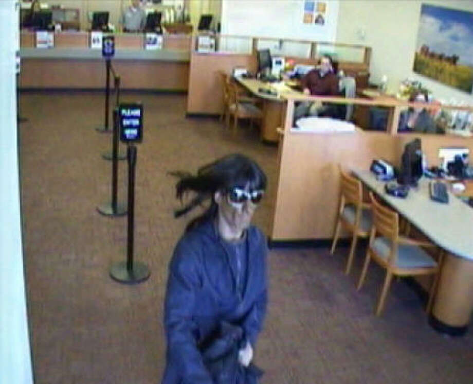 Surveillance photo from the March 2010 robbery of a Friendswood Wells Fargo branch at East Parkwood near West Bay Area Boulevard. Photo: Pearland Police Department