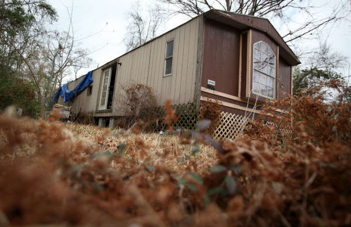 """Police say some of the sexual assaults of an 11-year-old girl occurred at this abandoned trailer house in a part of Cleveland called """"the Hood."""""""