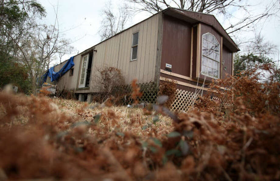"Police say some of the sexual assaults of an 11-year-old girl occurred at this abandoned trailer house in a part of Cleveland called ""the Hood."" Photo: Mayra Beltran, Chronicle"