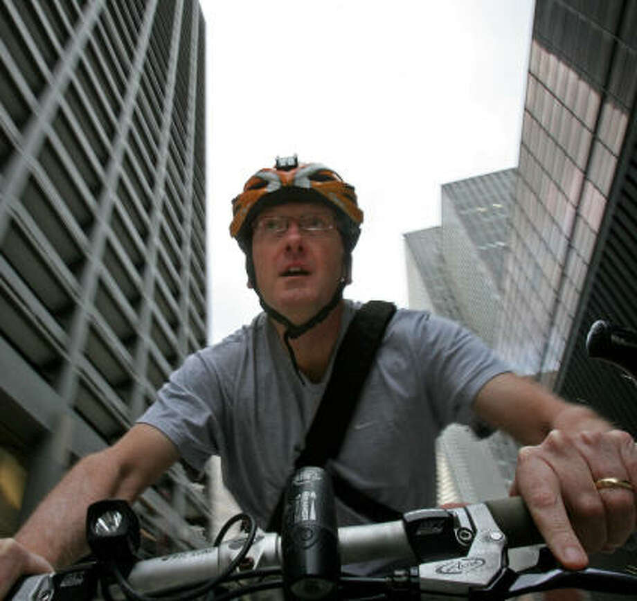 "Michael Skelly calls his 30-minute bicycle commute ""an awesome way to start the day."" Photo: Johnny Hanson, Chronicle"