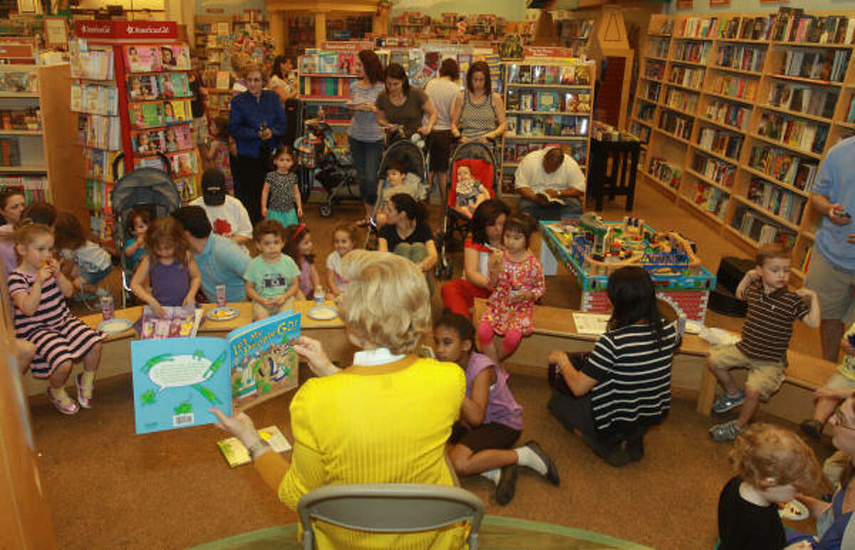 Volunteer reader Fran Friedman reads Let My People Go! during Passover Story Time at Barnes & Noble in Bellaire.
