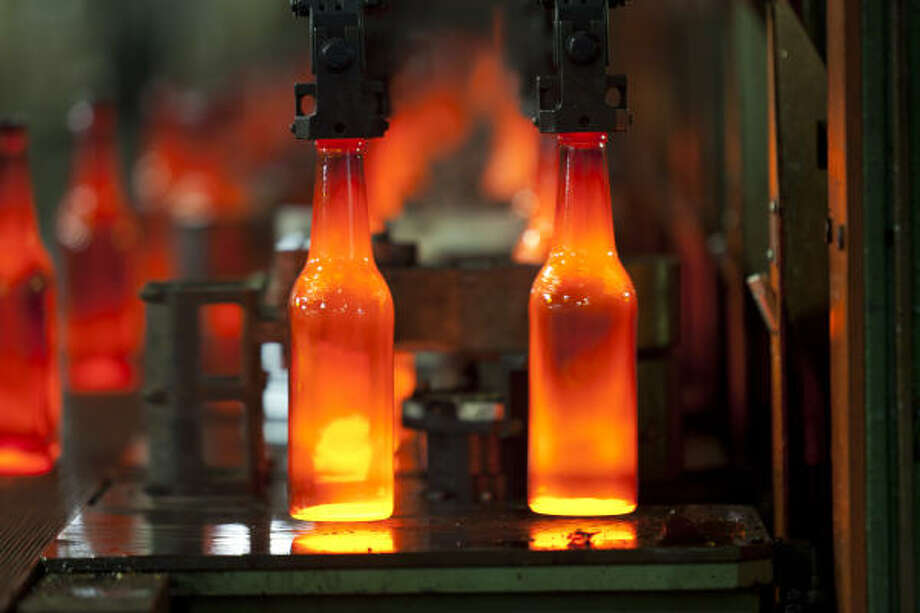 Bottles are made at Longhorn Glass Co. Every 11 years Longhorn has to overhaul the factory, where the furnace heats glass up to 2,800 degrees Fahrenheit. Photo: Nathan Lindstrom :, For The Chronicle