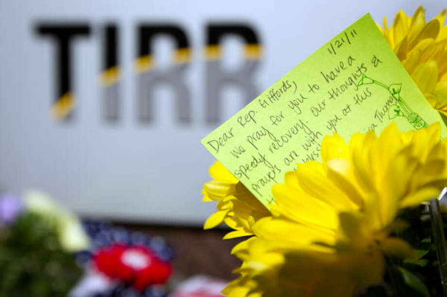 A card expressing support for U.S. Rep. Gabrielle Giffords sits among flowers left outside Memorial Hermann's Institute of Rehabilitation and Research on Saturday. Photo: Smiley N. Pool, Chronicle