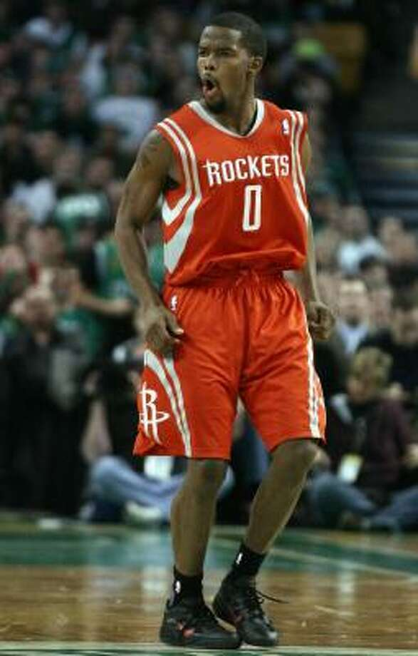 Rockets guard Aaron Brooks celebrates one of the five 3-pointers he made in Monday night's win. Photo: Elsa, Getty Images