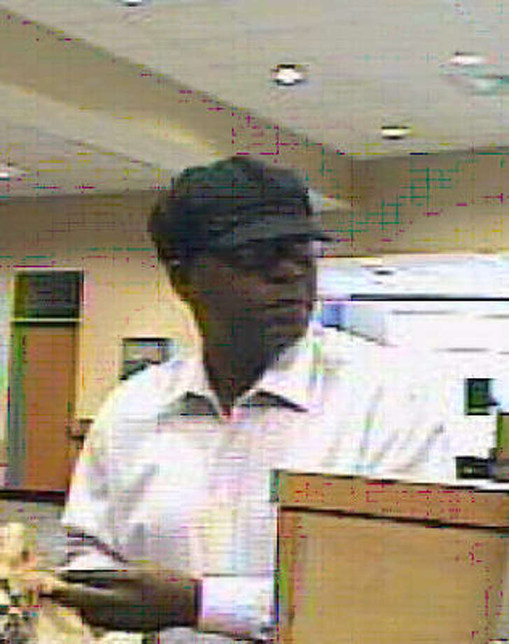 A surveillance camera captured the robbery of Capital One Bank at 20503 FM 529 near Cypress Springs High School. Photo: FBI