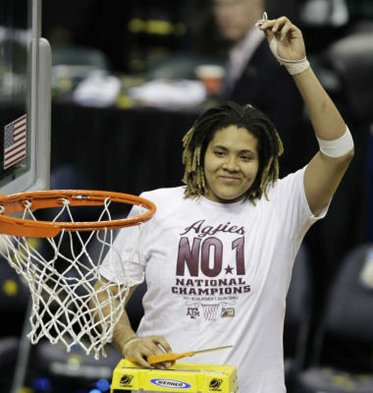 Texas A&M's Danielle Adams holds a piece of the net after Texas A&M's 76-70 win over Notre Dame in the women's final on Tuesday night in Indianapolis.