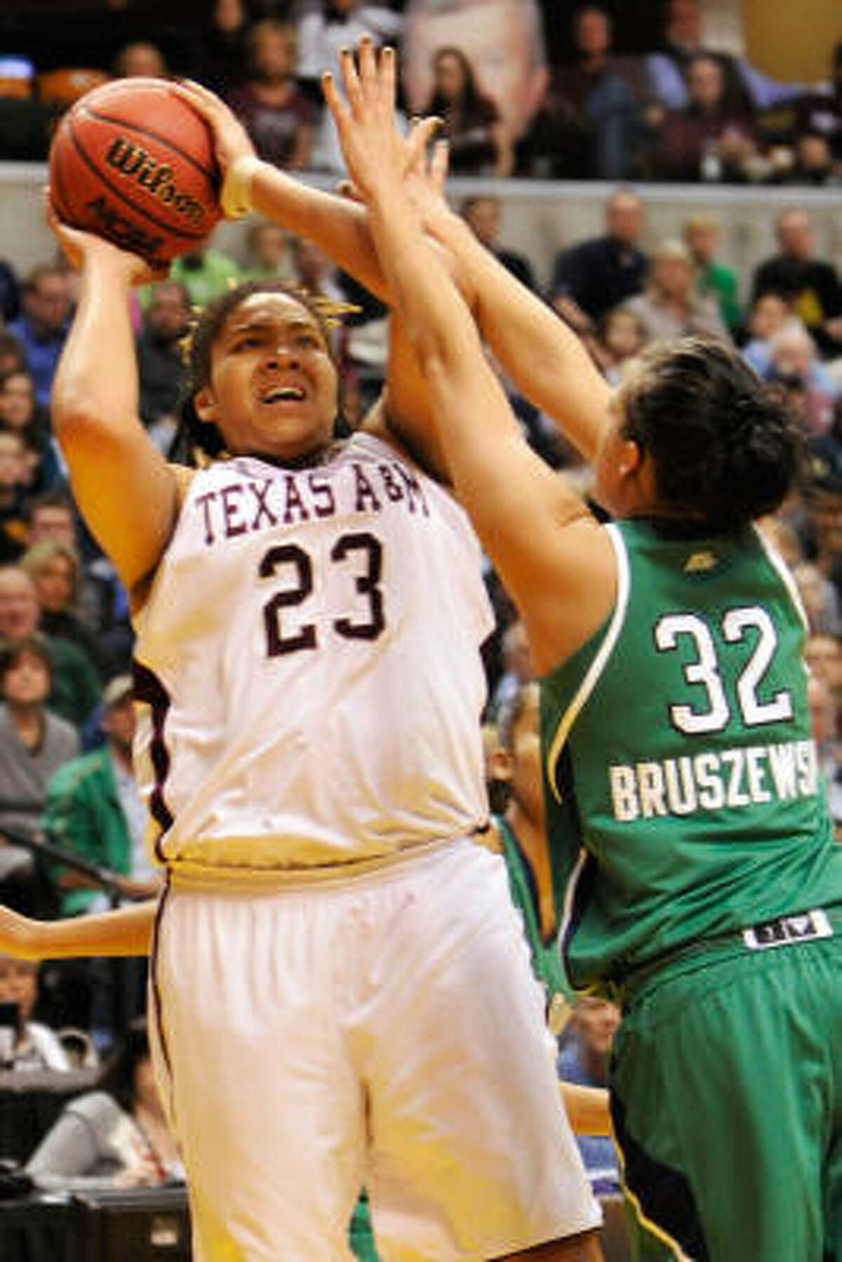 Texas A&M's Danielle Adams looks to score two of her 30 points in Tuesday night's victory.