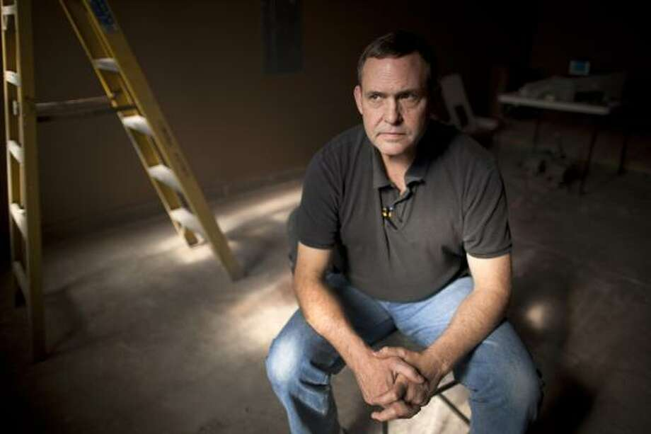 Alan Ackerly and his wife walked away from their home, which was worth less than what he owed on it. The Ackerly house is now among a growing crop of empty residences in Nevada, where a mighty boom has dissolved into a sink pit of foreclosures, bankruptcies and abandoned homes. Photo: Julie Jacobson:, AP