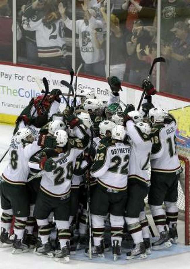 The Aeros celebrate after beating the Hamilton Bulldogs 4-3 in Game 7 on Tuesday night. Photo: Cody Duty, Houston Chronicle