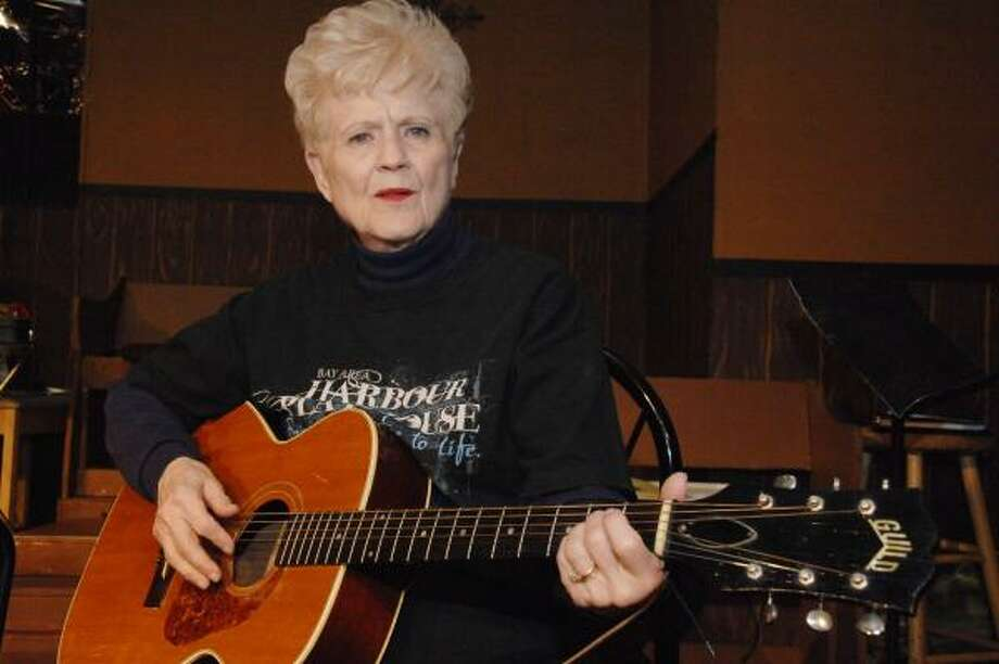 ON GUITAR: Retired Friendswood High teacher Bennie Nipper rehearses a song for Smoke on the Mountain Homecoming, which she is directing at the Bay Area Harbour Playhouse in Dickinson. Photo: JIMMY LOYD, FOR THE CHRONICLE