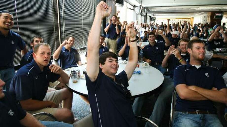 Rice catcher Andrew Murphy, center, his teammates and fans react to Rice getting the No. 8 national seed Monday. Photo: Nick De La Torre, Chronicle