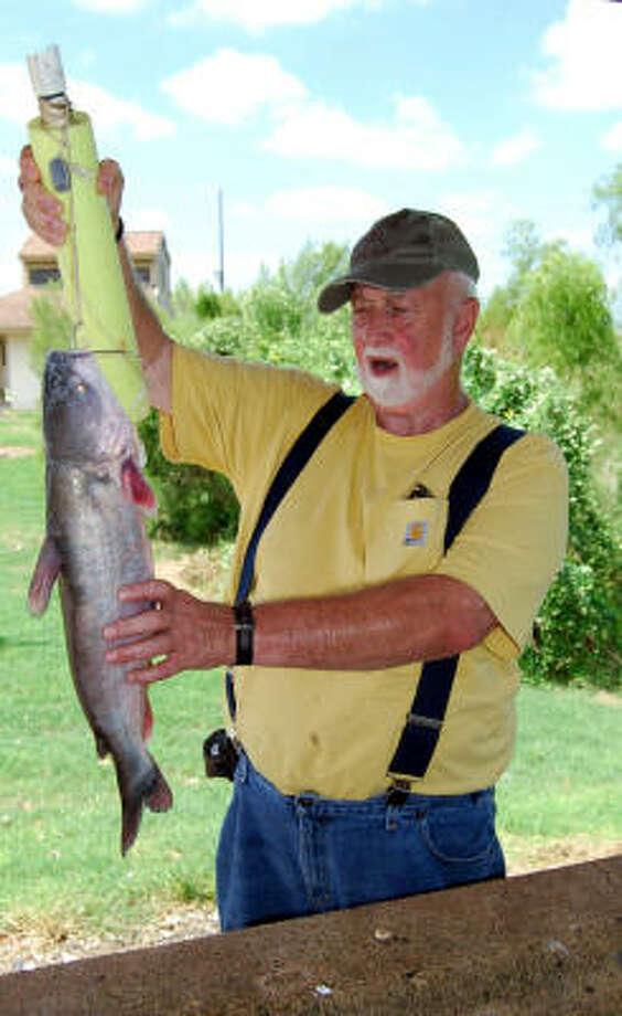 Harvey Winingham shows off a blue catfish that fell victim to a noodle set on Choke Canyon Reservoir in South Texas. Photo: RALPH WININGHAM, FOR THE CHRONICLE