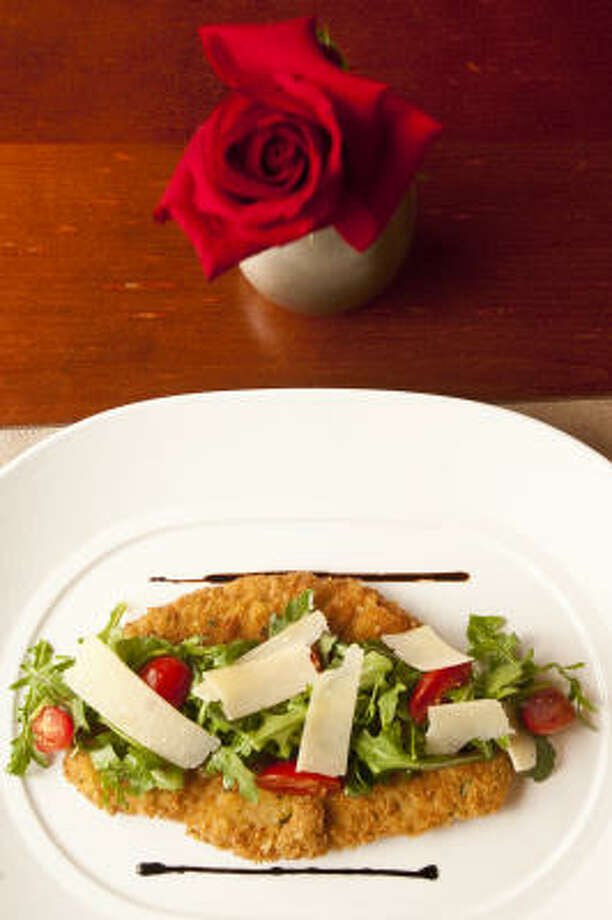 Cotoletta di Vitello alla Milanese: Breaded veal cutlet, arugula salad, cherry tomato and shaved Parmesan cheese Photo: Nick De La Torre :, Houston Chronicle