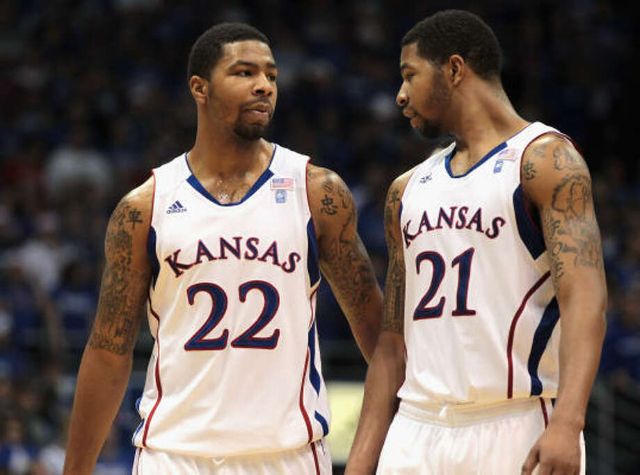 Marcus Morris, left, and his twin brother Markieff have given second-ranked Kansas an unexpected lift. Marcus leads the 18-0 Jayhawks with a 17.2-point average; Markieff tops the Big 12 powerhouse on the boards with 8.7 per game. Photo: Jamie Squire, Getty Images