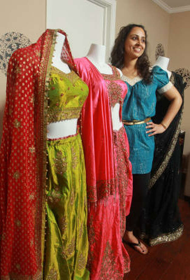 Sonal Parikh displays a sample from her collection of trendy Indian saris for rent. She has a website and works by appointment only. But she also hopes to open a shop. Photo: Gary Fountain :, For The Chronicle