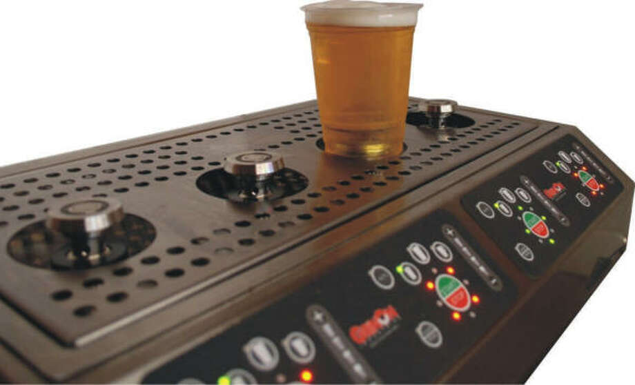 The Bottoms Up Draft Beer Dispensing System works by filling beer from the bottom, then sealing the metal-lined hole with a magnet. Photo: GrinOn Industries