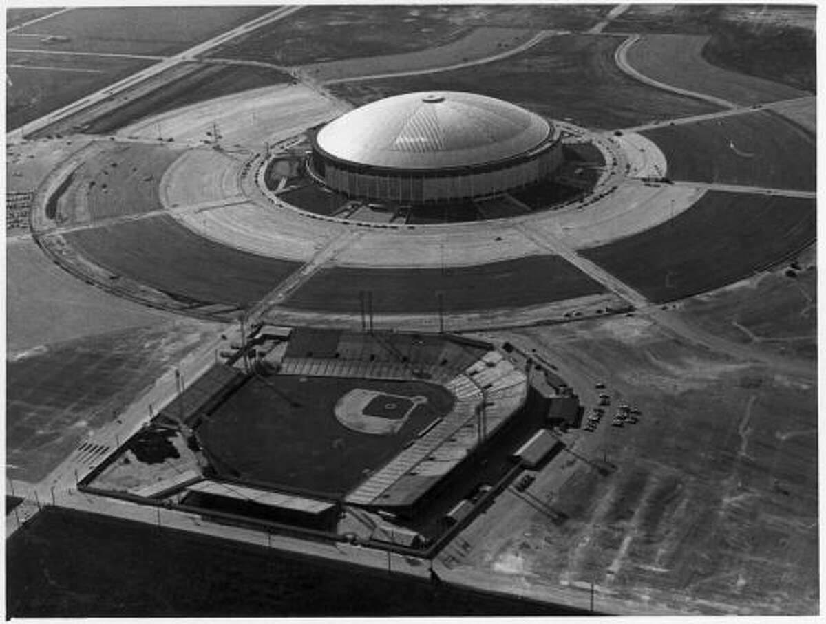 The Astrodome with Colt Stadium in the foreground, May 1965.