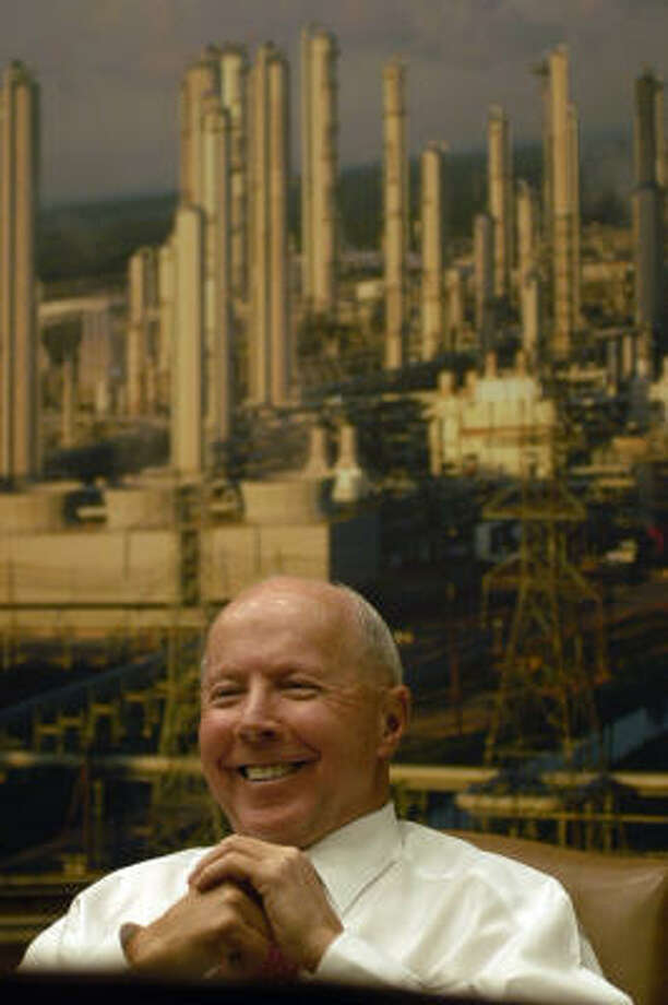 Dan Duncan, chairman of EPCO, Inc., sits in front of a photograph of his Mont Belvieu natural gas facility, at his Houston office, Wednesday, Feb. 1, 2006 while being interviewed. At the age of 73, Duncan is still putting in 40 to 80 hours a week doing what he loves to do... make deals and growing his company. Duncan was recently listed 93rd on the list of Americas richest people in Forbes magazine. (Johnny Hanson for the Houston Chronicle) Photo: Johnny Hanson, For The Chronicle